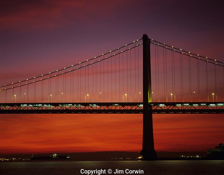 San Francisco Oakland Bay bridge at sunrise with street lights and bridge lights, San Francisco, California USA