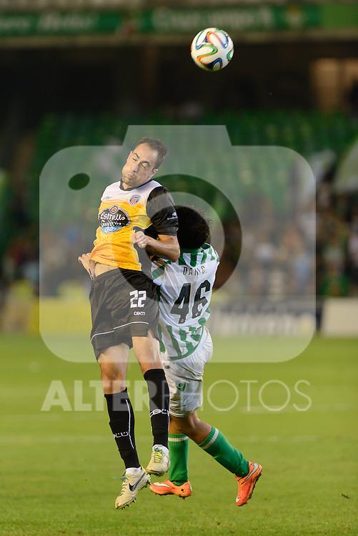 Sevilla, España, 15 de octubre de 2014: Lolo Pavon (I) y Dani (D) intentando hacerse con un  balon aerero durnate el partido entre Real Betis y Lugo correspondiente a la jornada 5 de la Copa del Rey 2014-2015 celebrado en el estadio Benito Villamarain de Sevilla.