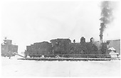 Engineer's side view of K-27 #464 being turned in Durango on a snowy day.  Partial view of K-37 #493 tender.<br /> D&amp;RGW  Durango, CO  Taken by Stampfli, Walter H. Jr. - 12/19/1951