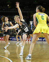 Silver Ferns Laura Langman looks to block the pass from Natalie von Bertouch during the netball test match between the Silver Ferns v Australia played at the Sydney Superdome, Sydney Australia, 29th June 2005. The Silver Ferns won 50-43. ©Michael Bradley