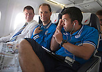 FC Luzern v St Johnstone...16.07.14  Europa League 2nd Round Qualifier<br /> Callum Davidson, Alec Cleland and Manager Tommy Wright on the flight over to Basel in Switzerland ahead of tomorrow's game against FC Luzern<br /> Picture by Graeme Hart.<br /> Copyright Perthshire Picture Agency<br /> Tel: 01738 623350  Mobile: 07990 594431
