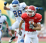 SIOUX FALLS, SD - SEPTEMBER 7:  Ned Sudbeck #7 from Lincoln returns a punt for a touchdown past Ben Johnson #88 from O'Gorman in the second quarter of their game at the 2013 Presidents Bowl at Howard Wood Field. (Photo by Dave Eggen/Inertia)