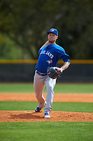 Toronto Blue Jays pitcher Jon Harris (39) during an exhibition game against the Canada Junior National Team on March 8, 2020 at Baseball City in St. Petersburg, Florida.  (Mike Janes/Four Seam Images)