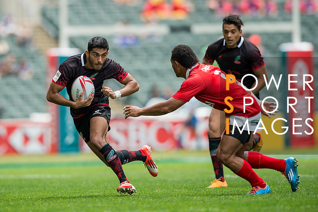 Tonga (in red) vs Morocco (in black) during the HK Rugby Sevens 2016 on 08 April 2016 at Hong Kong Football Club in Hong Kong, China. Photo by Li Man Yuen / Power Sport Images