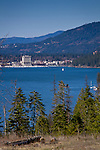 Idaho, North, Kootenai County, Coeur d'Alene. Looking across Lake Coeur d'Alene on a blue sky day, towards the tourist town of Coeur d'Alene in spring.