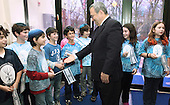 Israeli Defense Minister Ehud Barak greets students as he arrives at the Jewish Primary Day School of the Nation's Capital in Washington DC, December 15, 2011. Barak, also a former prime minister, toured the school, spoke in both Hebrew and English with kids in two classrooms and listened as they sang Israeli songs. The visit was part of the school's Yitzhak Rabin memorial series, named for the late prime minister.  ..Mandatory Credit: Chris Kleponis - H/O via CNP