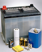 BATTERIES: FOUR TYPES<br /> Auto, Nickel Cadmium, Alkaline &amp; Zinc Dry Cell<br /> (left to right) Lead-based automobile; 3 types of rechargeable nickel-cadmium; 3 types of alkaline; Zinc graphite dry cell. A battery consists of one or more voltaic cells. When connected in series the emf is the sum of the emf's of the individual cells.
