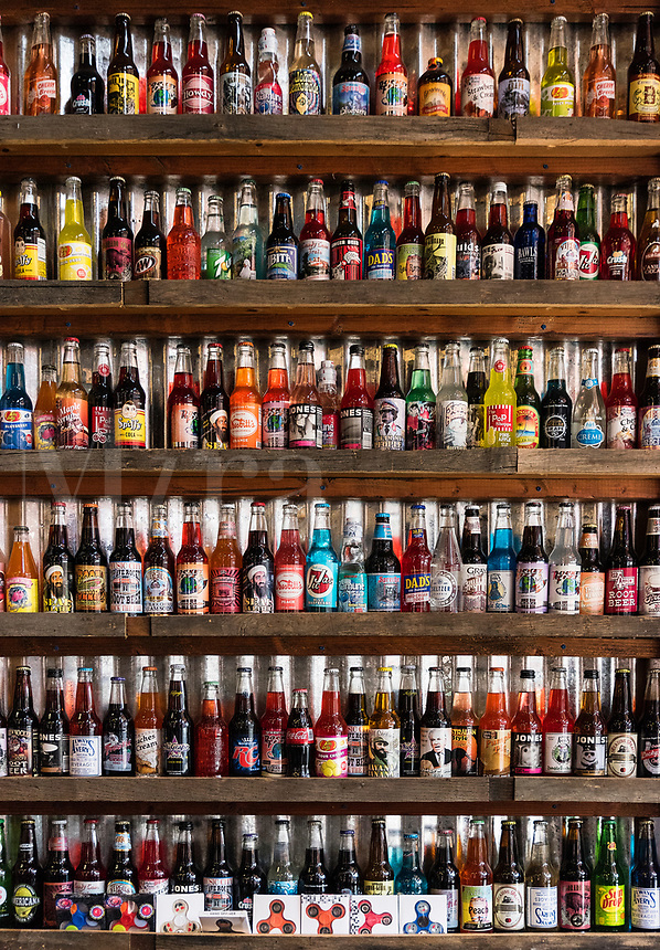 Colorful display of unique soda brands.