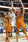 forward Nina Davis (13) passes past center Kelsey Lang (40) during Big 12 women's basketball championship final, Sunday, March 08, 2015 in Dallas, Tex. (Dan Wozniak/TFV Media via AP Images)