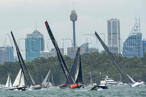 26.12.2015 Sydney, Australia. Rolex Sydney to Hobart Yacht race 2015. Comanche owned by Jim Clark & Kristy Hinze Clark from SA skippered by skipper Ken Read type 100 Supermaxi,Wild Oats XI owned by Robert Oatley from NSW skippered by Mark Richards type RP100,Rambler owned by George David from the USA type Jk 27m Canting Maxi during the start of the 629 nautical mile race from Sydney to Hobart on Sydney Harbour.