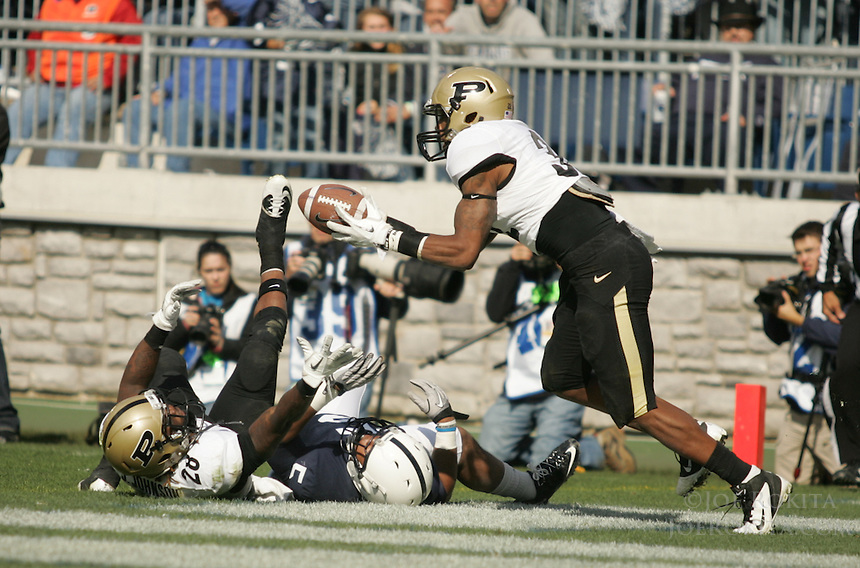 State College, PA - 10/15/2011:  Purdue safety Albert Evans grabs the football to complete an acrobatic interception after the ball was tipped by fellow defender Josh Johnson (28), and away from Penn State receiver Bill Belton.  Penn State defeated Purdue by a score of 23-18 on October 15, 2011, homecoming, at Beaver Stadium...Photo:  Joe Rokita / JoeRokita.com..Photo ©2011 Joe Rokita Photography