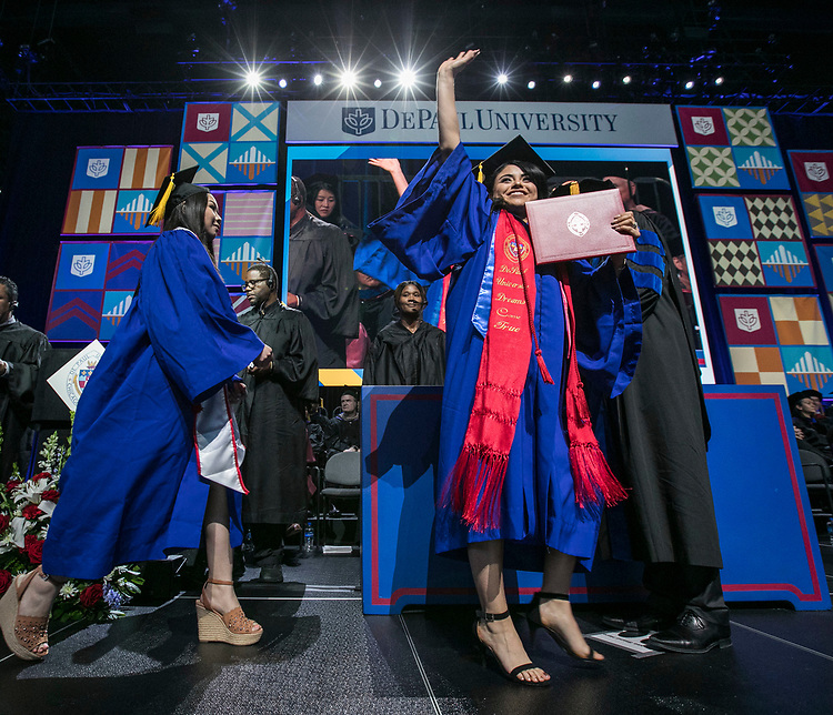 Graduates celebrate as they receive their diplomas during the commencement ceremony for the Driehaus College of Business, Sunday, June 10, 2018, at the Wintrust Arena in Chicago, IL. Approximately 6,700 students graduated during five ceremonies held over the weekend. (DePaul University/Jamie Moncrief)