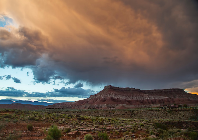 Storm clouds hover over Hurricane Mesa near Zion National Park, Utah