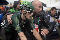 Pierre Rolland (FRA/Europcar) escorted away to warm up asap after finishing<br /> <br /> stage 12: Lannemezan - Plateau de Beille (195km)<br /> 2015 Tour de France