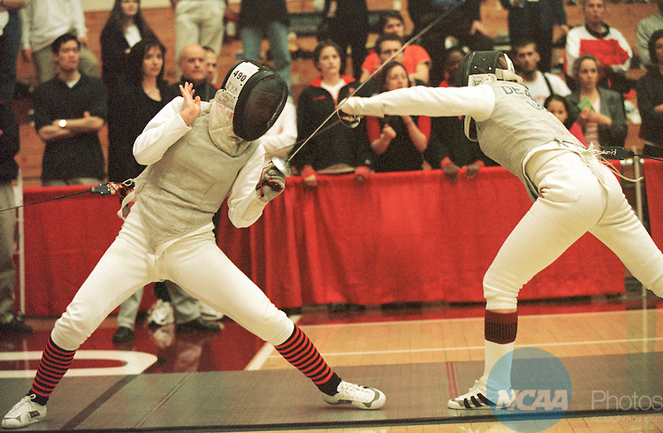 26 MAR 2000:  Eva Petschnigg of Princeton deflects an attack by Monique de Bruin of Stanford in the Foil competition during the 2000 NCAA Women's Fencing championships held on the Stanford University campus in Stanford, CA.  Petschnigg defeated de Bruin for the national championship.  Hector Amezcua/NCAA Photos