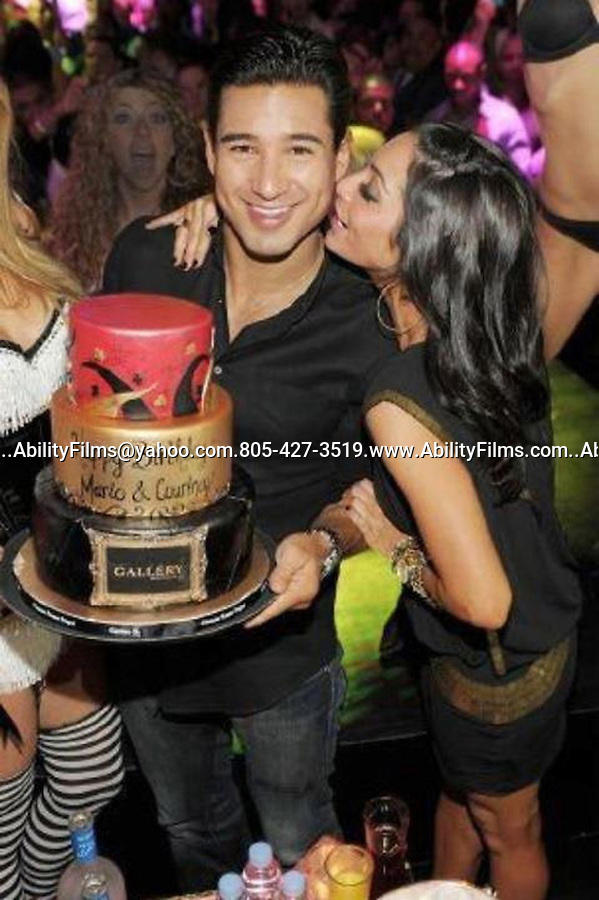 October 8th 2011     Saturday night ..Mario Lopez holding a cake celebrating his 38th birthday in Las Vegas with his girl friend Courtney Mazza ...AbilityFilms@yahoo.com.805-427-3519.www.AbilityFilms.com..
