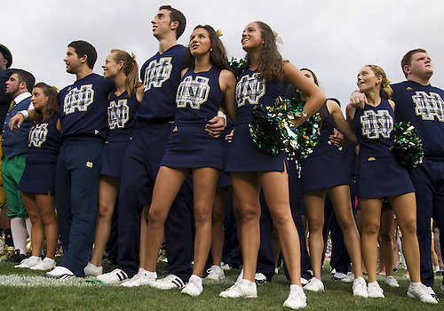 August 31, 2013: Notre Dame cheerleaders perform after NCAA Football game action between the Notre Dame Fighting Irish and the Temple Owls at Notre Dame Stadium in South Bend, Indiana.  Notre Dame defeated Temple 28-6.
