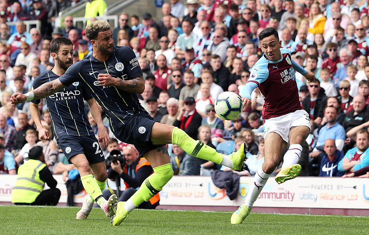 Burnley's Dwight McNeil crosses despite the attentions of Manchester City's Kyle Walker<br /> <br /> Photographer Rich Linley/CameraSport<br /> <br /> The Premier League - Burnley v Manchester City - Sunday 28th April 2019 - Turf Moor - Burnley<br /> <br /> World Copyright © 2019 CameraSport. All rights reserved. 43 Linden Ave. Countesthorpe. Leicester. England. LE8 5PG - Tel: +44 (0) 116 277 4147 - admin@camerasport.com - www.camerasport.com