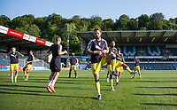 AFC Wimbledon players warm up ahead of the pre season friendly 'Cherry Red Records Cup' match between Wycombe Wanderers and AFC Wimbledon at Adams Park, High Wycombe, England on 25 July 2017. Photo by Andy Rowland.