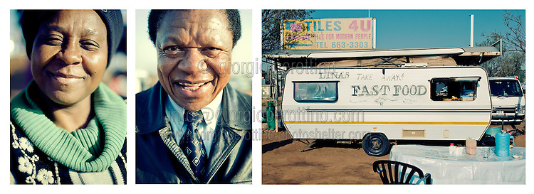 """A woman and a man pose at the bus station in Irene, Johannesburg as they gather for the morning breakfast before going to work.<br /> <br /> """"Where we live, where we leave"""".<br /> Faces and places in Johannesburg.<br /> South Africa, 2010."""