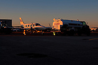 The sun set on a 1974 Piper PA-28R-200 immatriculated C-GOZE and on a ESSO oil truck at the Quebec City Jean Lesage International Airport, also known as Jean Lesage International Airport (French: Aeroport international Jean-Lesage de Quebec, or Aeroport de Quebec) (IATA: YQB, ICAO: CYQB) November 11, 2009.