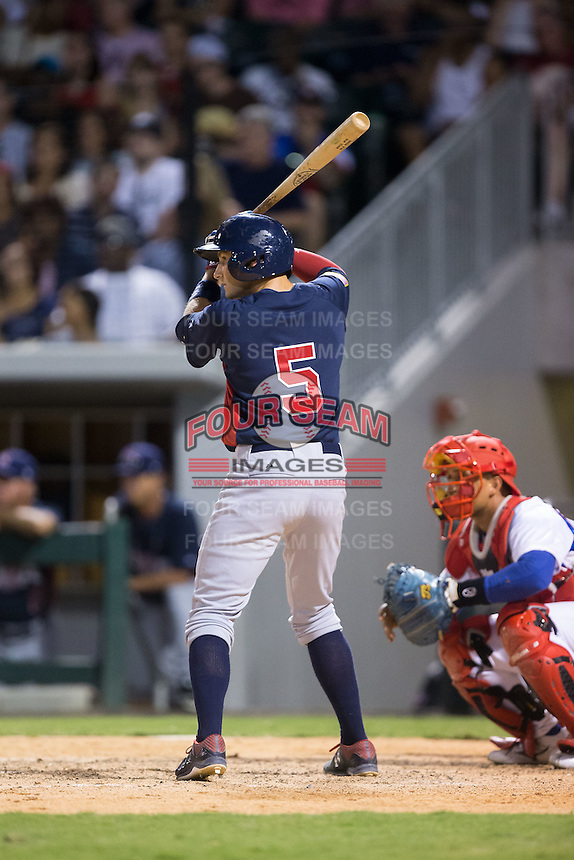 Garrett Hampson (5) of the US Collegiate National Team at bat against the Cuban National Team at BB&T BallPark on July 4, 2015 in Charlotte, North Carolina.  The United State Collegiate National Team defeated the Cuban National Team 11-1.  (Brian Westerholt/Four Seam Images)