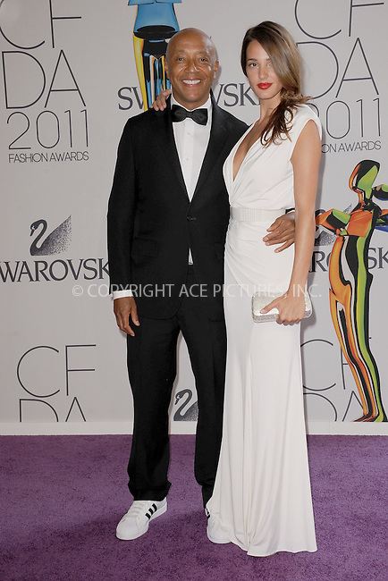 WWW.ACEPIXS.COM . . . . . .June 6, 2011...New York City.....Russell Simmons and Angela Bellotte attends the 2011 CFDA Fashion Awards at Alice Tully Hall, Lincoln Center on June 6, 2011 in New York City......Please byline: KRISTIN CALLAHAN - ACEPIXS.COM.. . . . . . ..Ace Pictures, Inc: ..tel: (212) 243 8787 or (646) 769 0430..e-mail: info@acepixs.com..web: http://www.acepixs.com .