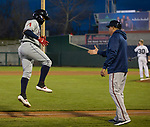 Reno Aces Juniel Querecutovs jumps as he gets a high five after hitting a homerun against the Nevada Wolf Pack at Greater Nevada Field in downtown Reno, Nevada on Tuesday, April 2, 2019.