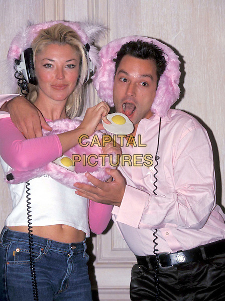 TAMARA BECKWITH & TOBY ANSTIS.Ref: 8908.funny, pink headphones, eggs, half length, half-length.www.capitalpictures.com.sales@capitalpictures.com.© Capital Pictures