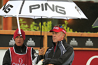 Miguel Angel Jimenez (ESP) and caddy Cliff on the 1st tee during a wet Saturday's Round 3 of the 2017 Omega European Masters held at Golf Club Crans-Sur-Sierre, Crans Montana, Switzerland. 9th September 2017.<br /> Picture: Eoin Clarke | Golffile<br /> <br /> <br /> All photos usage must carry mandatory copyright credit (&copy; Golffile | Eoin Clarke)