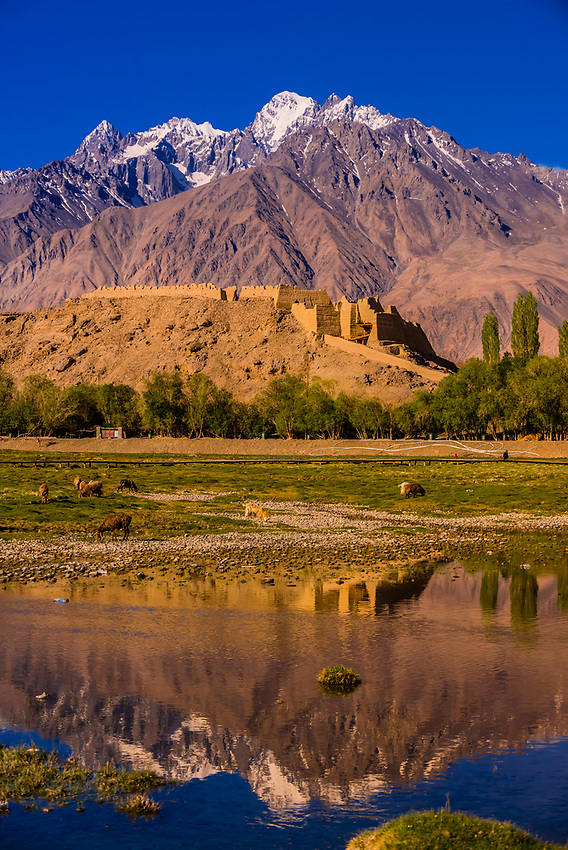 "The Stone Castle,  in Tashkurgan, Xinjiang Province, China with the Pamir Mountains behind. Tashkurgan means ""the stone castle"" in Uygur. The town sits at 10,100 feet, along the Karakoram Highway. It was a caravan stop on the Silk Road and all routes of the Silk Road converged here to journey southward to Pakistan. It sits on the borders of both Afghanistan and Tajikistan, and is close to the border of Kyrgyzstan and Pakistan.  The majority population in the town are ethnic Mountain Tajiks. Xinjiang Province, China."