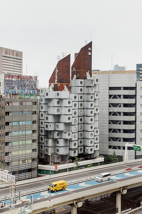 Tokyo, Japan, July 8 2016 - The Nakagin Capsule Tower, designed by architect Kisho Kurokawa and completed in 1972. It is a rare example of Metabolism architecture movement.