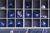Oklahoma City Dodgers batting helmets sit in the dugout during a game against the Iowa Cubs at Chickasaw Bricktown Ballpark on April 9, 2016 in Oklahoma City, Oklahoma.  Oklahoma City defeated Iowa 12-1 (William Purnell/Four Seam Images)