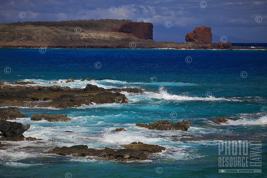 A view of Hulopo'e Bay and Sweetheart Rock (a.k.a. Pu'u Pehe Rock) near Hulopo'e Bay, Lana'i.