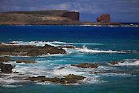 A view of Hulopo'e Bay and Sweetheart Rock (a.k.a. Pu'u Pehe Rock) near Hulopo'e Bay, Lana'i.