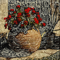 Lush red geraniums grace the round clay pot and brighten everyone's day.<br />