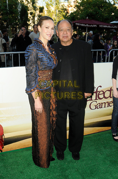 """NATASHA RUBIN & CHEECH MARIN.""""The Perfect Game"""" Los Angeles Premiere held At The Pacific Theaters at the Grove, Los Angeles, California, USA. .April 5th, 2010 .full length black blue print jacket dress brown married husband wife .CAP/ROT.©Lee Roth/Capital Pictures"""