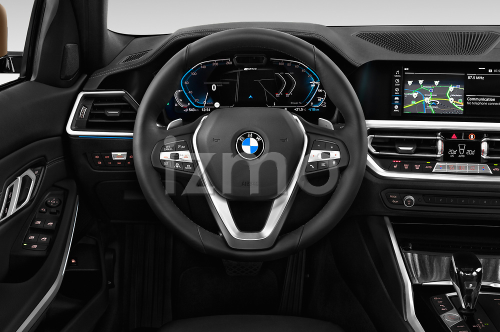 Car pictures of steering wheel view of a 2019 BMW 3 Series Sport PHEV 4 Door Sedan