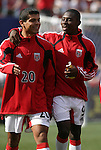 17 April 2004: Ronald Cerritos (20) and Freddy Adu (9) walk to the DC United bench before the game. The MetroStars defeated DC United 3-2 at Giants Stadium in East Rutherford, NJ during a regular season Major League Soccer game...