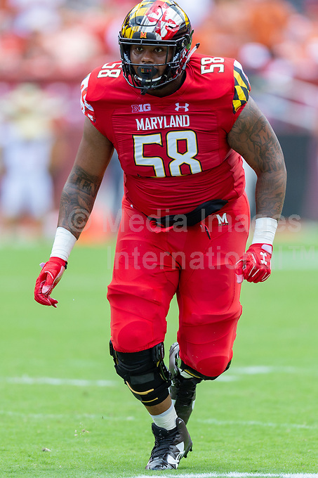 Landover, MD - September 1, 2018: Maryland Terrapins offensive lineman Damian Prince (58) looks for someone to block during game between Maryland and No. 23 ranked Texas at FedEx Field in Landover, MD. The Terrapins upset the Longhorns in back to back season openers with a 34-29 win. (Photo by Phillip Peters/Media Images International)