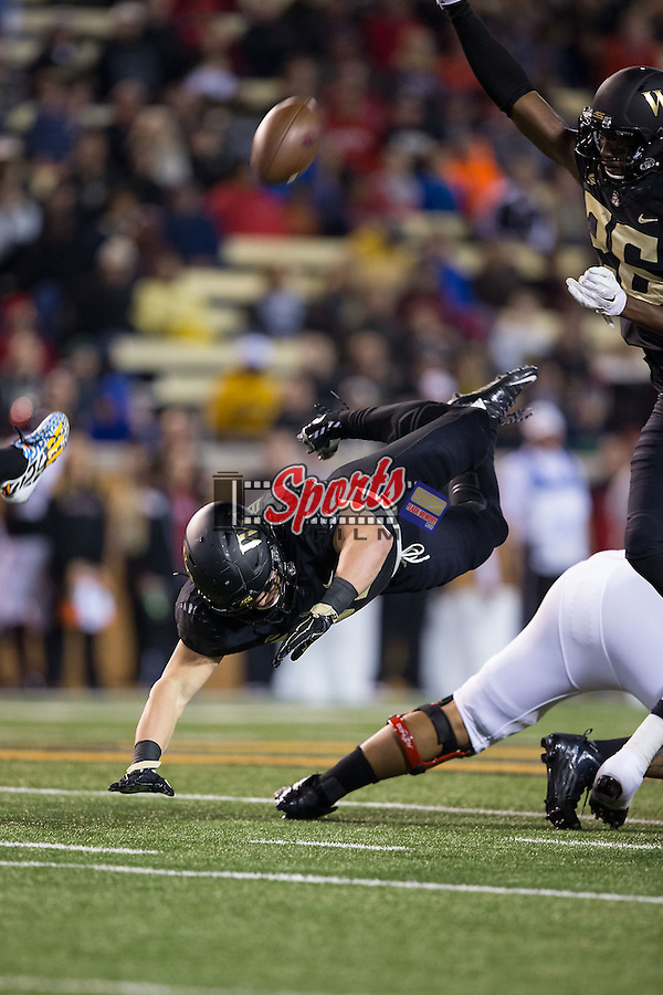 Grant Dawson (50) of the Wake Forest Demon Deacons goes airborne as he attempts to block a punt during first half action against the Louisville Cardinals at BB&T Field on October 30, 2015 in Winston-Salem, North Carolina.  The Cardinals defeated the Demon Deacons 20-19.  (Brian Westerholt/Sports On Film)