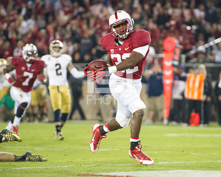 STANFORD, CA - November 30, 2013: Stanford Cardinal running back Anthony Wilkerson (32) making a touchdown run during the Stanford Cardinal vs the Notre Dame Irish at Stanford Stadium in Stanford, CA. Final score Stanford Cardinal 27, Notre Dame Irish  20.