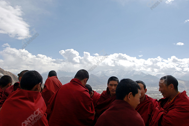 Monks took a break while reading through the Bhuddist commandments at the Drepung Monastery in the Tibetan capital, Lhasa. November 19, 2006