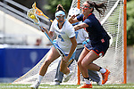 01 May 2016: North Carolina's Marie McCool (4) and Syracuse's Kelly Cross (right). The University of North Carolina Tar Heels played the Syracuse University Orange at Lane Stadium in Blacksburg, Virginia in the 2016 Atlantic Coast Conference Women's Lacrosse Tournament championship match. North Carolina won 15-14 in overtime.