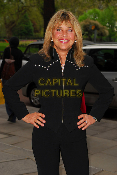 SUZI QUATRO .Arrivals at the Sony Radio Academy Awards 2006 at Grosvenor House Hotel, London, UK..May 8th, 2006.Ref: CAN.half length black jacket hands on hips.www.capitalpictures.com.sales@capitalpictures.com.© Capital Pictures.