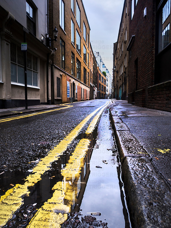 Back street, london, uk with double yellow line indicating no parking
