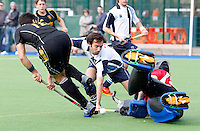 Cesar Hauet (C) and Ian Scanlon (R) combine to block a Beeston player during the HA Mens Cup Semi-Final between Hampstead & Westminster and Beeston at the Paddington Recreation Ground, Maida Vale on Sun March 20, 2011