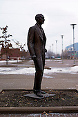 Dearborn, Michigan<br /> USA<br /> February 17, 2011<br /> <br /> A statue of Henry Ford stands outside the former Ford Rouge Steel Plant. The plant was completed in 1928 is now owned, run and being renovated and expanded by Russian owner &quot;Severstal North America&quot;. This is one of five steel plants owned by Severstal in the United States and they are spending huge sums to convert it into what could be the continent's most efficient automotive steel plant.<br /> <br /> Rouge Steel fell on hard times after Ford Motor Company spun it off in 1989 into an independent steel company. <br /> <br /> After buying the assets of the bankrupt company for USD 280 million, Severstal spent USD 350 million to repair one of the blast furnaces. The company built a new cold-rolling line which converts steel slabs into sheet metal. And it added a galvanizing line which coats sheet metal with zinc for rust-resistant body panels.<br /> <br /> The operation assets and improvements amount to USD 1.4 billion. Add in spending on a new mini mill in Columbus, Mississippi a USD 1.6 billion operation and Severstal has placed a USD 3 billion bet on North America auto industry.