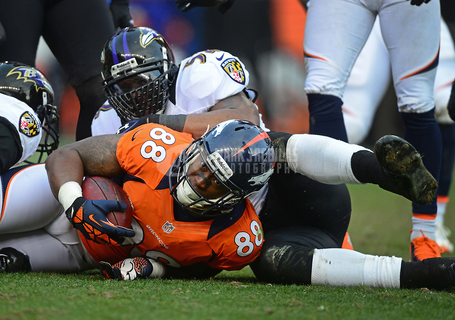 Jan 12, 2013; Denver, CO, USA; Denver Broncos wide receiver Demaryius Thomas (88) is tackled by Baltimore Ravens linebacker Ray Lewis during the AFC divisional round playoff game at Sports Authority Field.  Mandatory Credit: Mark J. Rebilas-