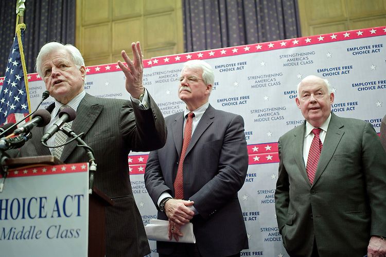 "02/06/07--Senate HELP Committee Chairman Edward Kennedy, D-Mass., House Education and Labor Chairman George Miller D-Calif., and John Sweeney, president of the AFL-CIO, during a news conference introducing  the ""Employee Free Choice Act."".The legislation would make it easier for unions to woo workers to their cause could be the first real test of organized laborÕs clout in the Democratic-controlled Congress. Labor advocates, who played a major role in helping Democrats gain the House and Senate, have made what is termed Òcard-checkÓ legislation a top lobbying priority. The measure (HR 800) was introduced by Miller and Kennedy, D-Mass., who chairs the Senate Health, Education, Labor and Pensions panel. Current law allows employers to insist on a second step, a vote by secret ballot after a majority of employees have signed cards, before a union can be certified as a bargaining agent. Not all employers choose to have an election. Under MillerÕs bill they would lose the option. It would do away with the second step, easing the path for organized labor. Under the current system, once an election date is set, employers are free to campaign against the union, and many do so actively. Labor groups, led by the AFL-CIO, say that gives management an opportunity to coerce workers to oppose the union. ÒFor too long, Congress has failed to act against the union-busting tactics now all too familiar in the workplace,Ó Kennedy said. ÒWe have a new Democratic Congress now. ItÕs up to us to pass this important bill, and we intend to do it.Ó Congressional Quarterly Photo by Scott J. Ferrell"